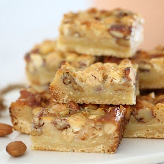 The easiest Nut Caramel Slice you'll ever make! Simply pour a can of condensed milk over a sweet base topped with mixed nuts. That's it!