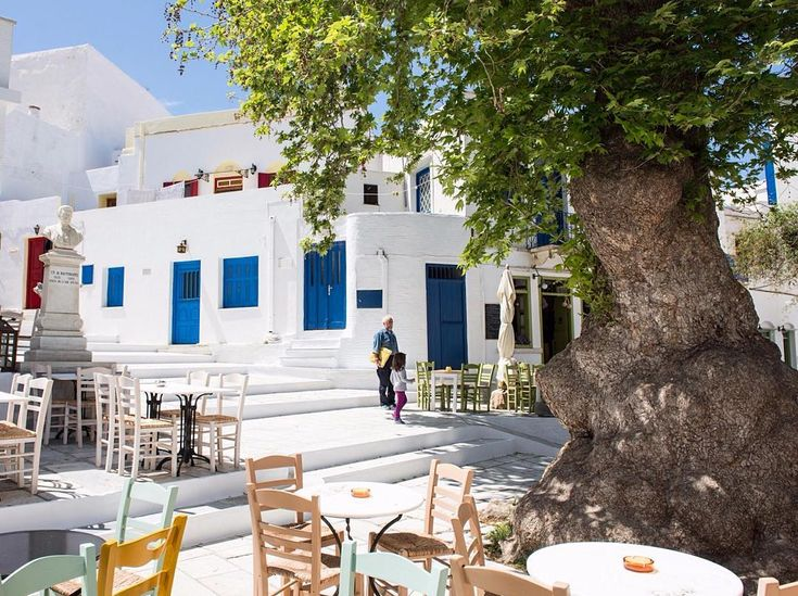 Tinos island (Τήνος). So picturesque and colorful center square of the village !!