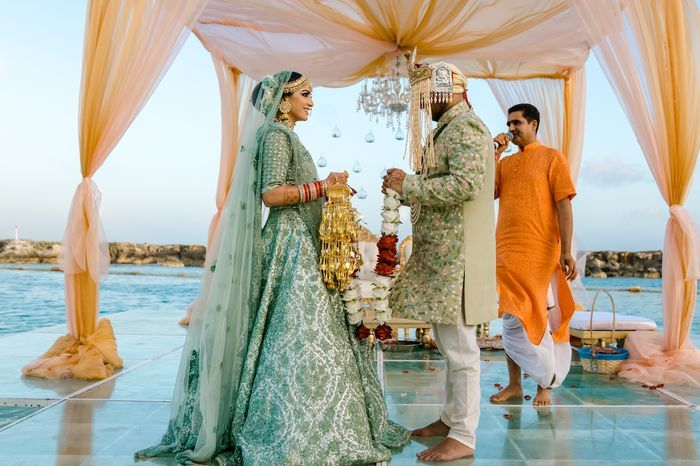 From A Beach Mandap To A Bridal Baraat This Wedding Had Some Unique Ideas In 2020 Mandap Indian Wedding Photography Wedding Couple Poses
