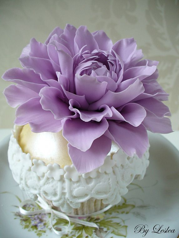 Gorgeous, ornate cupcake in gold and white with a huge purple bloom (they said dahlia, but is it not a peony?).