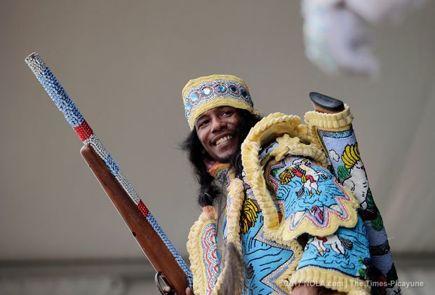 The Comanche Hunters Mardi Gras Indians perform on the Jazz and Heritage Stage during the New Orleans Jazz and Heritage Festival at the Fair Grounds in New Orleans on Saturday, April 29, 2017