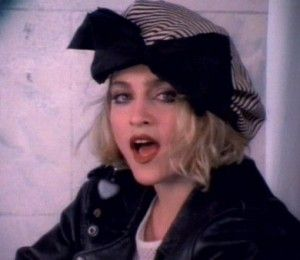 """Madonna (""""Borderline"""" video).  I loved this video way back when & I love it now.  Her floppy hat, over the top bow and the one dangly heart earring was awesome!  So funky and youthful."""