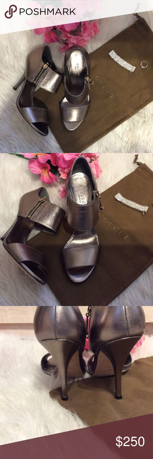 """Authentic Gucci pewter sandals Authentic Gucci leather heeled sandals. Worn once! In like new condition. Comes with Gucci dustbag. 4"""" heel. Zippers on side for closure. Bundle and save 15%. Size 36 1/2 Gucci Shoes Sandals"""