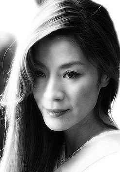 """Michelle Yeoh (born: August 6, 1962, Ipoh, Malaysia) is a Chinese-Malaysian actress. She is best known for performing her own stunts in the Hong Kong action films that brought her to fame in the early 1990s. She was chosen by People as one of the """"50 Most Beautiful People in the World"""" in 1997. She is best known in the Western world for her roles in the James Bond film Tomorrow Never Dies (1997) and the Chinese-language film Crouching Tiger, Hidden Dragon (2000),"""
