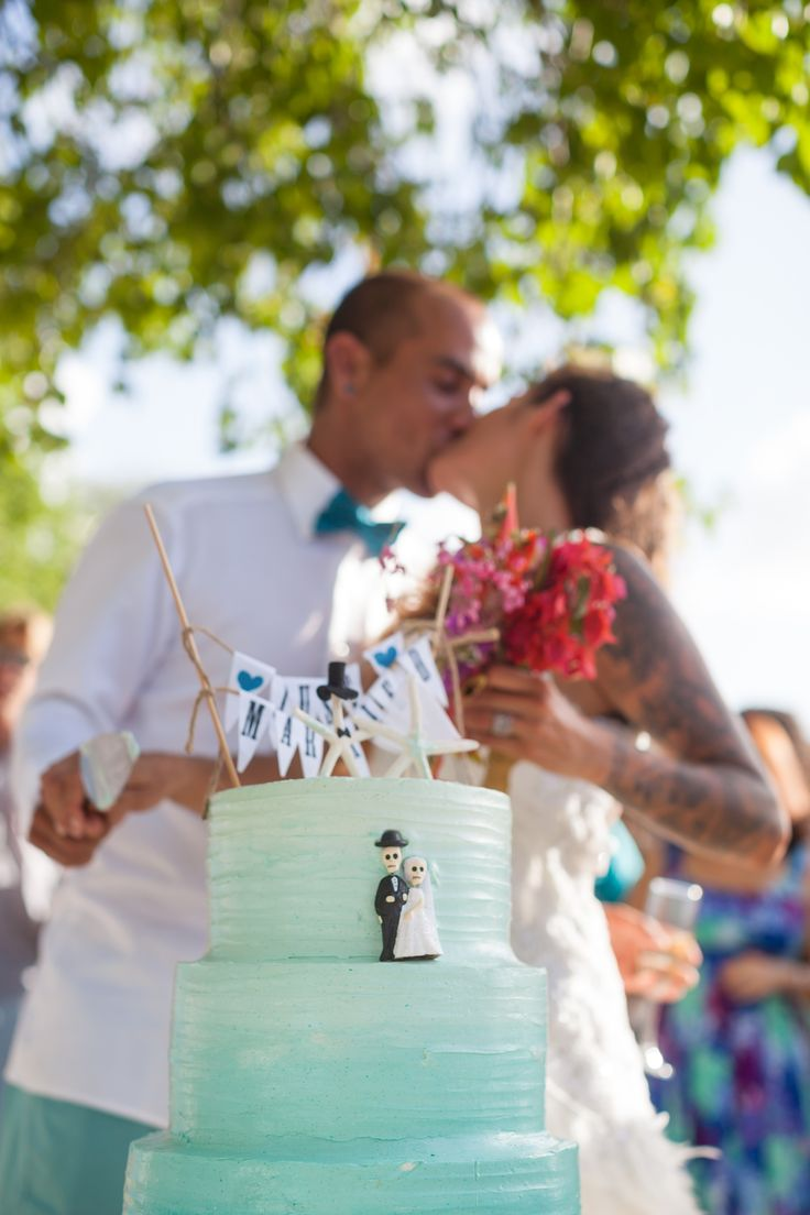 The turquoise, ombre wedding cake made by Brenda Campbell