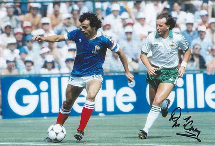 France 4 N. Ireland 1 in 1982 in Madrid. Michel Platini on the ball with David McCreery chasing at the World Cup Finals, group match.