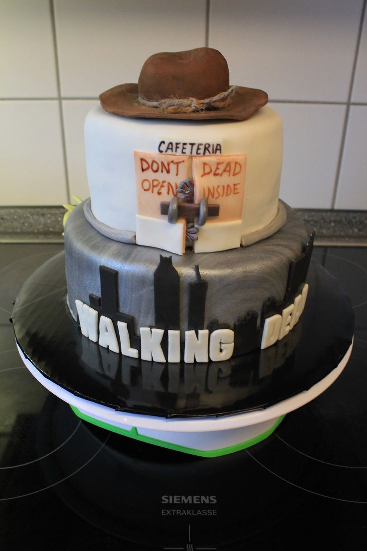 """Walking Dead themed cake I made for my husband's graduation. He had no idea it was for him & loved it :) Chocolate with Vanilla buttercream on bottom, carrot cake with vanilla cream cheese frosting on top. """"Rick's Hat"""" made from fondant & RKT Facebook.com/CakesByChristiSmith"""