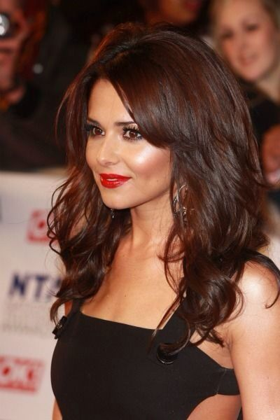 Cheryl Cole with brown long layered hair on her round face