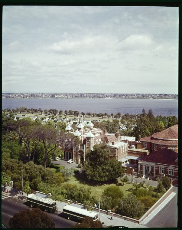 228148PD: Aerial view across St. George's Terrace, Government House and the Esplanade to the the Swan River, Perth, ca. 1962.  https://encore.slwa.wa.gov.au/iii/encore/record/C__Rb3756323