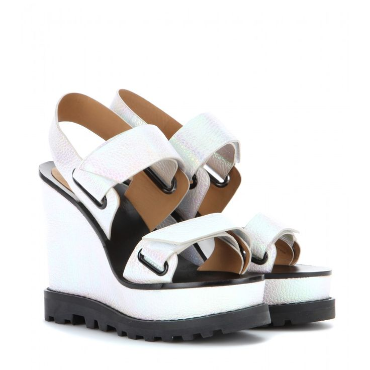 Marc by Marc Jacobs - Street Stomp leather wedges - They may not be khaki or camouflage, but Marc by Mac Jacobs' 'Street Stomp' sandals are military-inspired and ready to take on the new season's hottest trend. Shaped with an round open toe, they feature double straps and a wedge heel finished with a gripped rubber sole. Check out the white holographic coating - slick, contemporary and perfect for summer. seen @ www.mytheresa.com