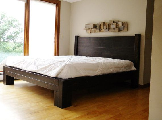 Platform Bed. Solid wood platform bed. Platform features a rough sawn rustic finish. Heavily textured yet smooth enough to prevent snagging