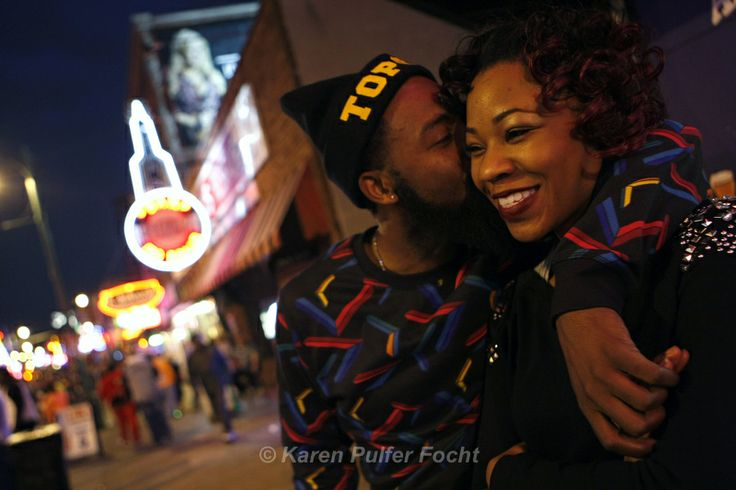 Hosea Butler and Tameka Watson of Memphis take in the sights and sounds of Beale Street as darkness falls and the nighttime crowd starts to build. ©Karen Pulfer Focht