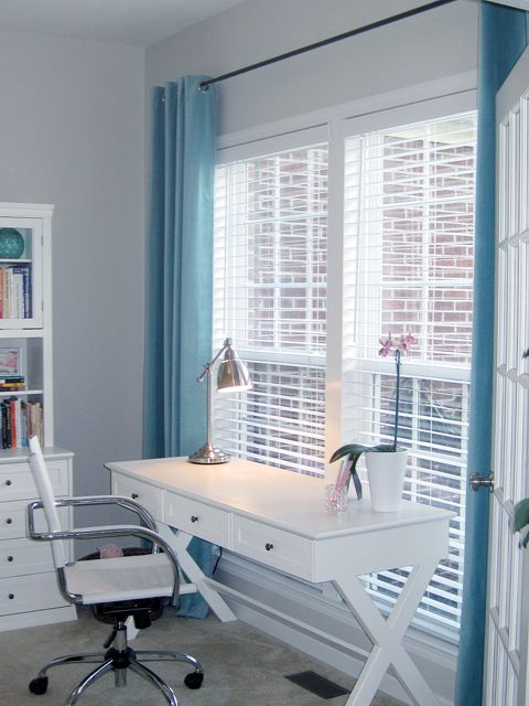 The white wooden venetian blind and blue curtain combination looks great with the white/grey walls. Good combo for a relaxing office space. #interiordesign #blinds #office