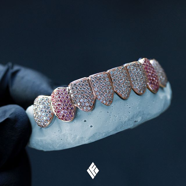 14K Rose Gold Bottom 8 Grills Fully Iced Out With White Diamonds And Pink Sapphires. Specially made for @oceannea_banana #Grillz #CustomJewelry #IFANDCO