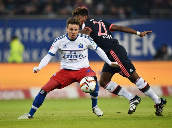 Nicolai Mueller of SV Hamburg evades David Alaba of Bayern Munich during the Bundesliga match between Hamburger SV and FC Bayern Muenchen at Volksparkstadion on January 22, 2016 in Hamburg, Germany.