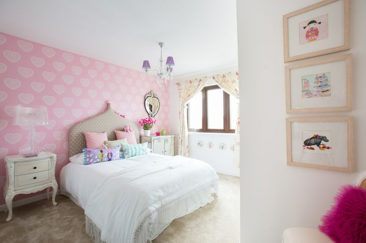 Girl's bedroom with lovely pink heart wallpaper