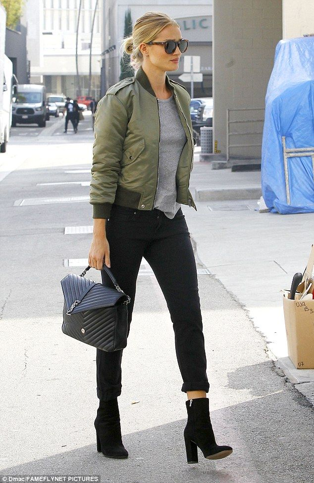 Added extras:The star accessorized the look with a pair of suede high heel boots and a Sa...