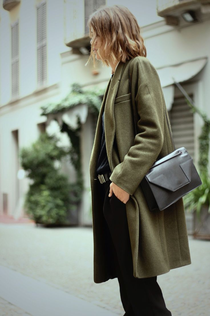 The green coat and the black side purse makes an excellent combination for a woman in streets for the city during the fall season maybe New York, Chicago anywhere cool just like this look.