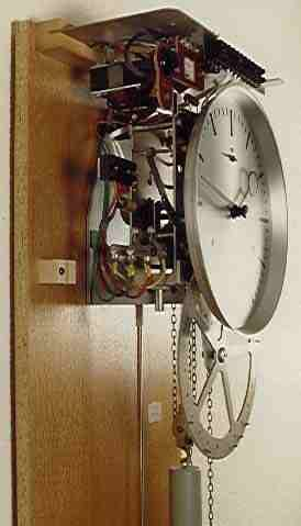 Antique Electric Clocks - Bürk clock from the Black Forest, around 1960. A small motor, switched by a mercury contact, does the winding.