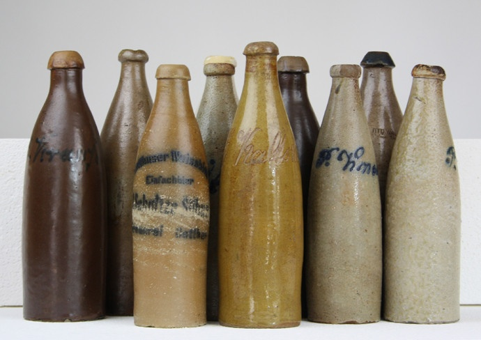 collection of antique stoneware bottles