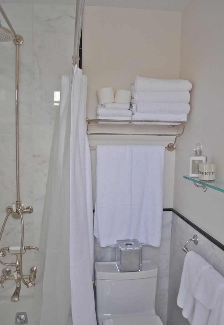 1946 yellow and grey tile bathroom - This Is A Tiny Lady S New York Apartment Bath With White Statuary Marble On The Walls Around The Bath Tub And Shower The Other Walls Trimmed With Black