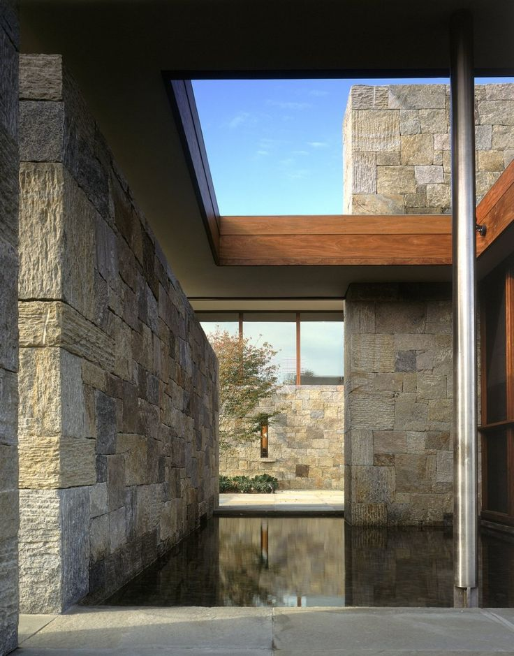 Courtyard among incredible stone walls with a simple reflecting pool.