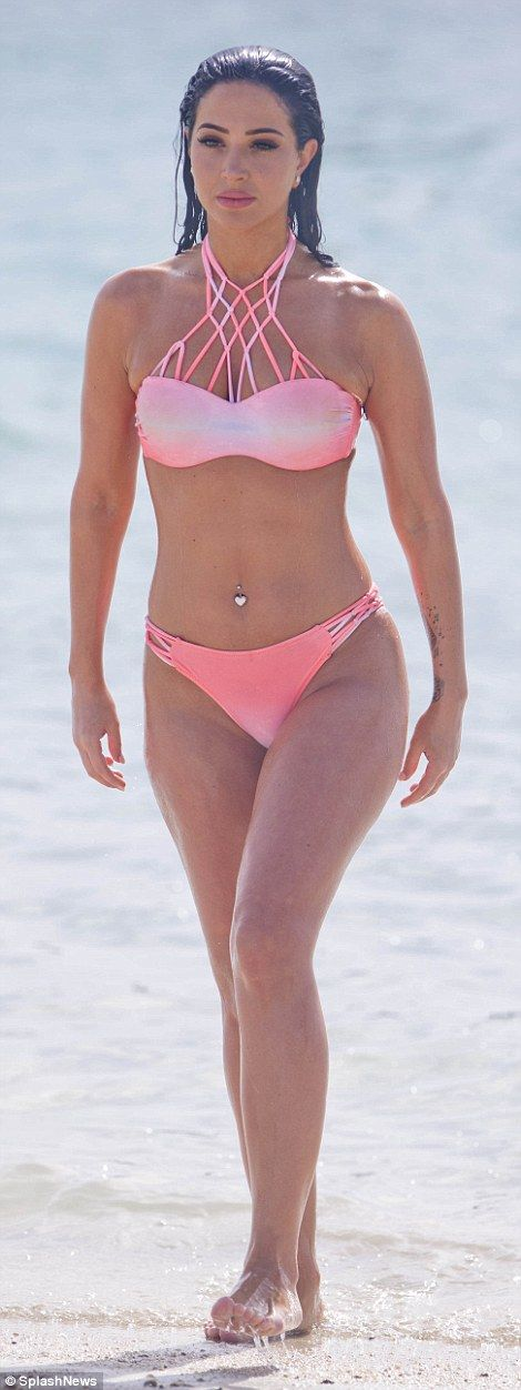 Tulisa Contostavlos flaunts sculpted figure in pink bikini in Dubai | Daily Mail Online