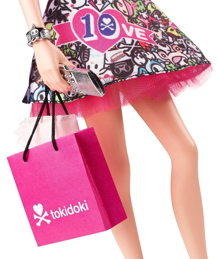 2015 10 Anniversary Tokidoki Barbie - Always at the forefront of cutting-edge fashion, Barbie collaborates with whimsical lifestyle brand, Tokidoki in celebration of the brand's 10th anniversary! Barbie is ready to shop all day and party.