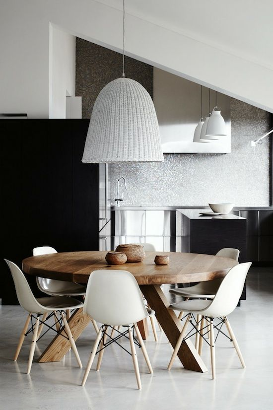 'DSW' dining chairs by Charles and Ray Eames, 'Tripod' table by Mark Tuckey and 'Bell 95' light by Gervasoni.