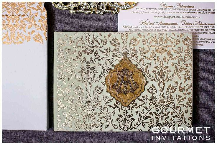A mint and gold wedding invitation with a secret garden theme. The invitation is mint velvet and we printed it with gold foil in a brocade floral pattern.