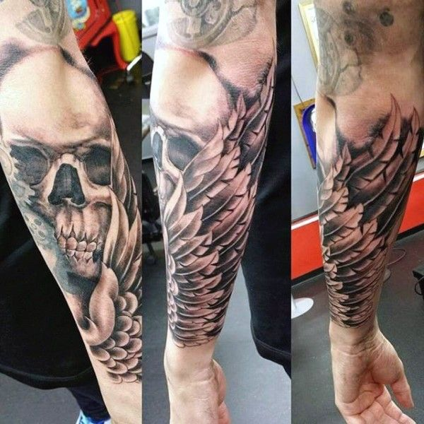 Original combined black and white skull with wings tattoo on sleeve