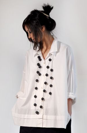 "Classic white shirt with a double collar and a 1"" tuck at the deep hem. And a fabulous necklace."