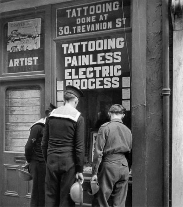 """painless tattooing"" Sailors standing at the door of a painless tattoo shop ~"
