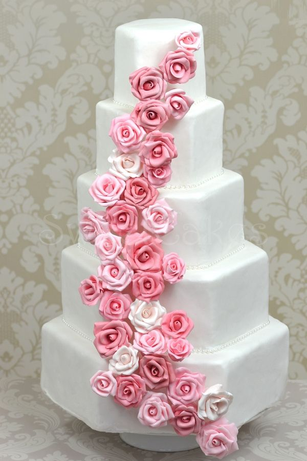 Hexagon shaped cakes with cascading pink sugar roses