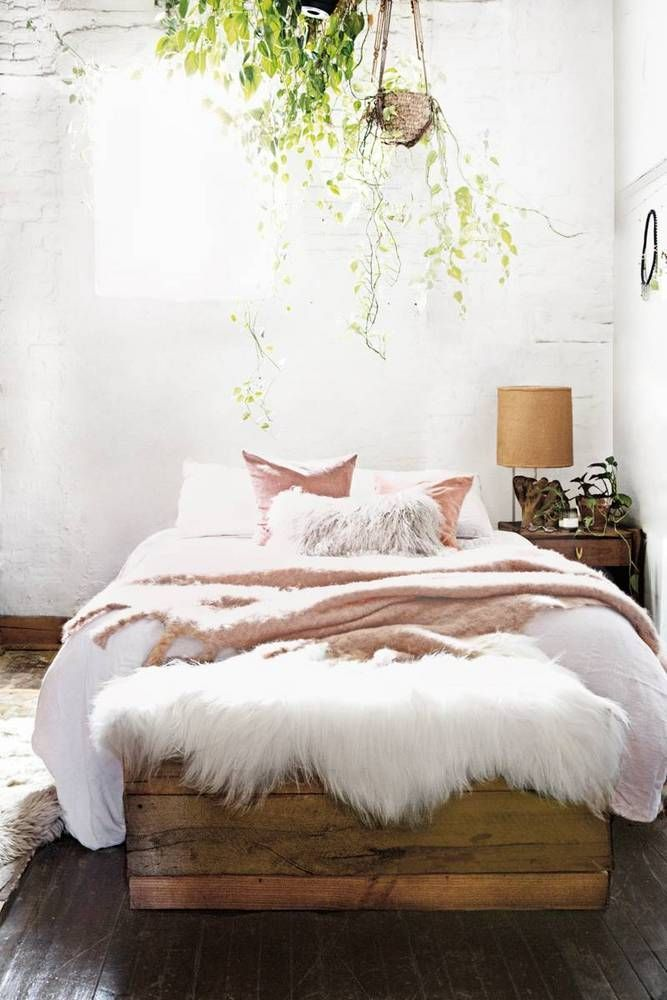 This bedroom looks like it's straight out of a cottage! How dreamy! I love the hints of contemporary with the bed sheets and the fur rug.