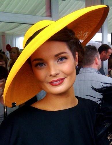 Lemon lamp dish hat w/ black band, faded red smile, deep blue eyes, curly short dark hair, navy billowy blouse; minty tent ~ Martha Lynn Millinery