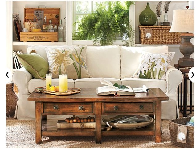 Love the wicker and bottles. Coffee table is cool but a little too rustic for my taste.