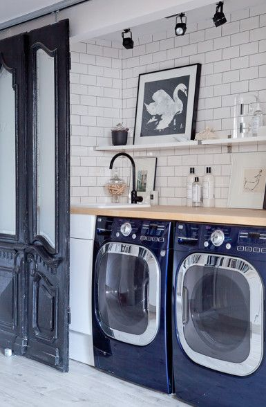 Hidden laundry room behind antique sliding doors eclecticallyvintage.com
