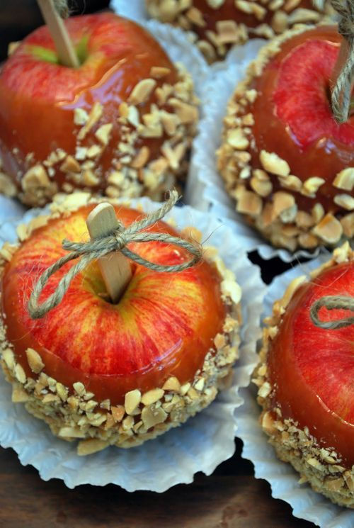 Caramel Apples. Fall festival ideas!  I really like the little twine bow on the the stick.