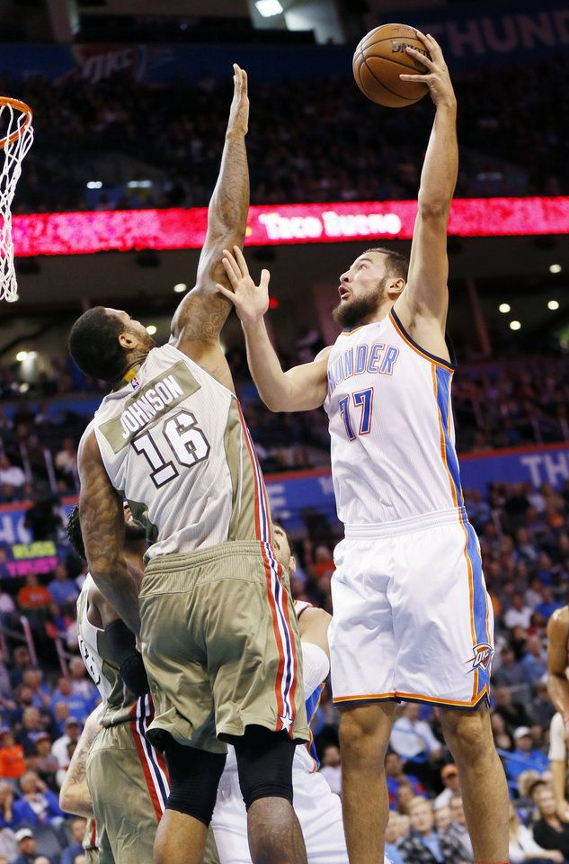 Oklahoma City's Joffrey Lauvergne (77) shoots against Miami's James Johnson (16) during an NBA basketball game between the Oklahoma City Thunder and the Miami Heat at Chesapeake Energy Arena in Oklahoma City, Monday, Nov. 7, 2016. Photo by Nate Billings, The Oklahoman