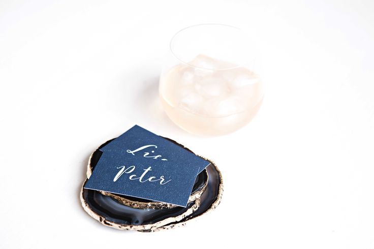 Place cards by @bellelovespaper stacked on the beautiful agate coasters by @hautecoshop