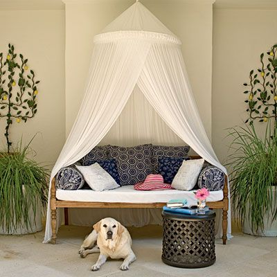 cozy little outdoor space created with a simple canopy and some cushions