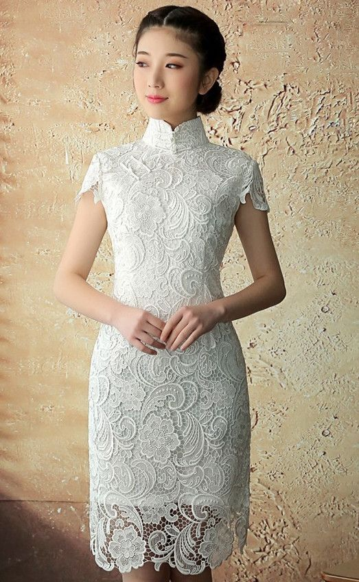 Bring with you some cultural flairs of the East in this entirely laced dress. Designed in an authentic traditional Chinese qipao style, featuring high enclosed collars, iconic side buttons, fitted wai