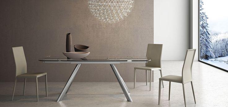 SIVIGLIA Tavolo allungabile (2 prolunghe da 35) struttura in metallo con top e allunghe in vetro trasparente   http://www.arredo3.it/tavoli/moderno/siviglia/