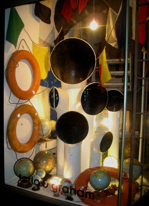 collection of ship's funnels, nautical signal flags and liferings