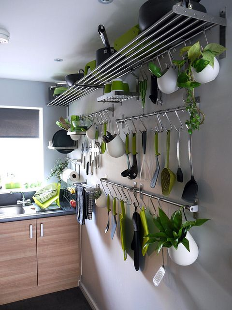 Great use of shelves and hooks to save on storage in a small kitchen.