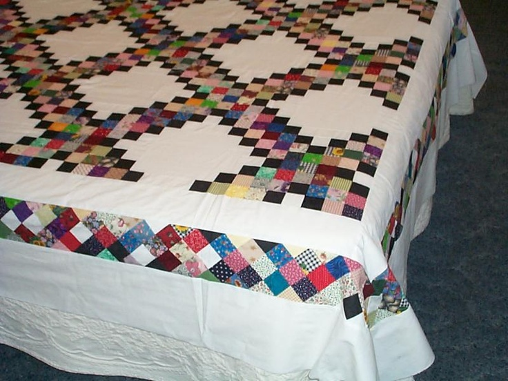 Scrappy Triple Irish Chain quilt - like the black on this one, also the pieced border. Could sub another dark color for the black, and I would use a medium to dark outside border or have the pieced border as the outside border. <3