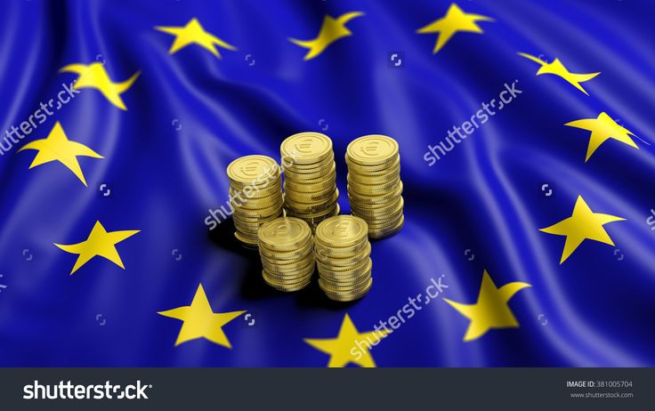 Stacks of Euro golden coins on wavy flag of European Union