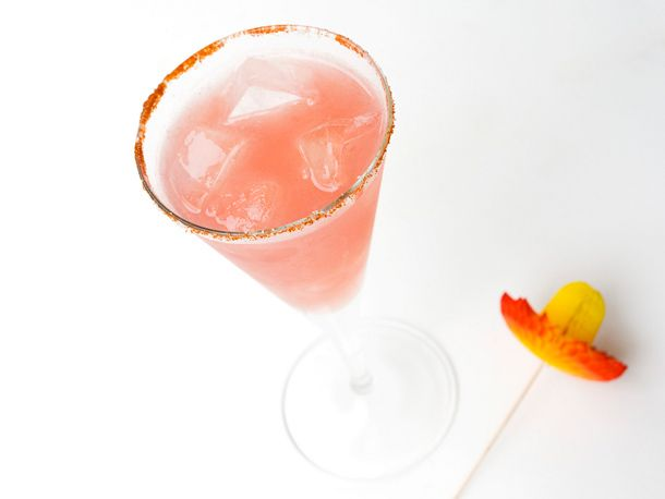 In-Sandiary   cocktail made with lime juice, watermelon juice, tequila, and a touch of agave.  rimmed glass with sugar, salt, and chili powder.  Made tonight and it was very yummy!