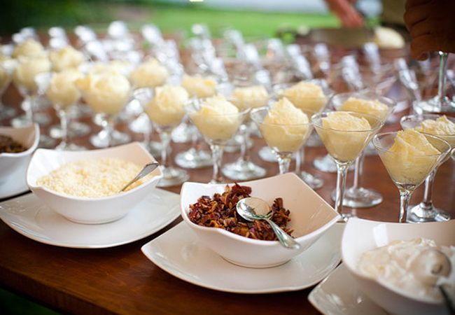 "Mashed Potato Bar...all the ""loaded"" toppings you can imagine, and pretty serving bowls (like the tater-tinis, shown).  This would be a hit in any group!"